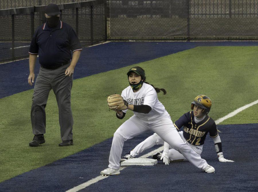 Mackenzie Dugie slides into third base