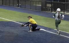 Alyssa LeBlanc catches the ball for an out