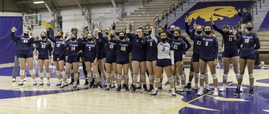 Student-athletes salute their university and their fans after defeating TWU