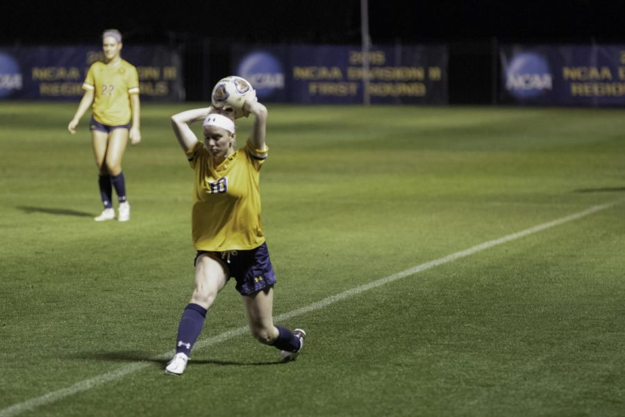 Gracie Spradling throws the ball into play